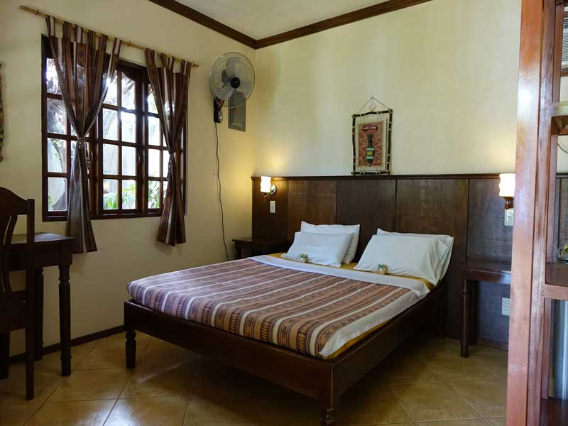 Queen bed room at Tipolo Beach resort