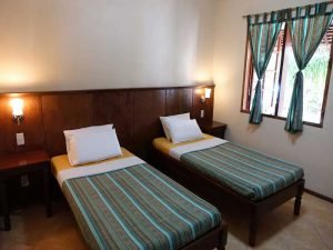 Twin bed room at Tipolo Beach resort